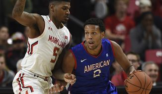 Maryland's Melo Trimble, left, reaches for a steal as American's Saeed Nelson dribbles during the second half of an NCAA college basketball game, Nov. 11, 2016 in College Park, Md. (AP Photo/Gail Burton) **FILE**