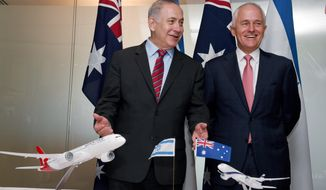Israeli Prime Minister Benjamin Netanyahu, left, and Australian Prime Minister Malcolm Turnbull share a laugh during the signing of agreements between the two countries at the Commonwealth Parliamentary offices in Sydney, Thursday, Feb. 23, 2017. Netanyahu is on a four-day visit to Australia, the first official visit by an Israeli prime minister. (Dean Lewins/Pool via AP)