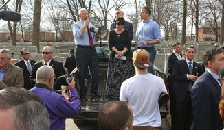 Vice President Mike Pence talks to the assembled crowd at the Chesed Shel Emeth Cemetery in University City, Mo., on Wednesday, Feb. 22, 2017, about the damage done over the weekend when more than 150 headstones were overturned by vandals. With the Vice President is Anita Feigenbaum, Executive Director of the cemetery, Alan Simon, President of the cemetery board, and Missouri Gov. Eric Greitens, right. (J.B. Forbes /St. Louis Post-Dispatch via AP)