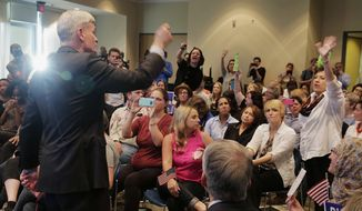 Sen. Bill Cassidy tries to pick a member among a crowd to listen to a question during his town hall meeting at East Jefferson Regional Library in Metairie, La., Wednesday, Feb. 22, 2017. (Andrew Boyd/NOLA.com The Times-Picayune via AP)