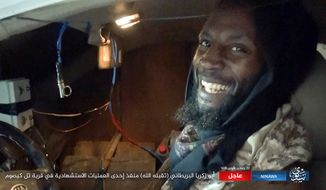 This militant photo released by Ninawa State, a media arm of the Islamic State terror group on Tuesday, Feb. 21, 2017 shows Abu Zakariya al-Britani, suicide bomber who attacked a military base in Iraq this week who was a former Guantanamo Bay detainee freed in 2004 after Britain lobbied for his release. The Islamic State group identified the bomber as Abu Zakariya al-Britani and two British security officials also confirmed the man featured in the Islamic State group video was a 50-year-old formerly Briton formerly known as Ronald Fiddler and as Jamal al-Harith. (Ninawa State via AP)