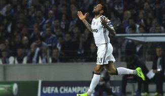 Juventus' Dani Alves celebrates after scoring his side's second goal during the Champions League round of 16, first leg, soccer match between FC Porto and Juventus at the Dragao stadium in Porto, Portugal, Wednesday, Feb. 22, 2017. (AP Photo/Paulo Duarte)