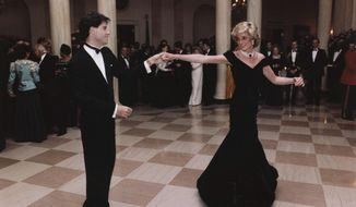 "In this Nov. 9, 1985, file photo provided by the Ronald Reagan Library, actor John Travolta dances with Princess Diana at a White House dinner in Washington. This outfit is featured in an exhibition of 25 dresses and outfits worn by Diana titled ""Diana: Her Fashion Story"" at Kensington Palace in London, opening on Friday, Feb. 24, 2017. (Ronald Reagan Library via AP, File)"