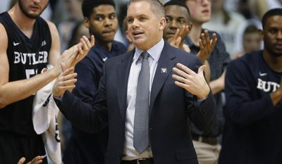 Butler coach Chris Holtmann stands in front of players on the bench during the first half of the team's NCAA college basketball game against Villanova, Wednesday, Feb. 22, 2017, in Villanova, Pa. (AP Photo/Laurence Kesterson)