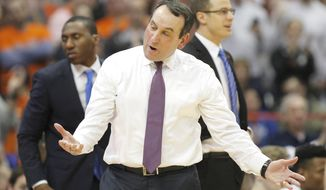 Duke head coach Mike Krzyzewski reacts to a call in the second half of an NCAA college basketball game against Syracuse in Syracuse, N.Y., Wednesday, Feb. 22, 2017. Syracuse won 78-75. (AP Photo/Nick Lisi)