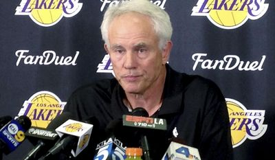 FILE - April 15, 2016 file photo Los Angeles Lakers general manager Mitch Kupchak speaks to reporters at team headquarters in El Segundo, Calif. The Los Angeles Lakers fired Kupchak Tuesday, Feb. 21, 2017, and put Magic Johnson in charge of basketball operations in a major shake-up of the struggling franchise's front office. (AP Photo/Greg Beacham, File)