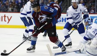 Colorado Avalanche right wing Jarome Iginla, left, looks to redirect the puck as Tampa Bay Lightning defenseman Anton Stralman, center, of Sweden, and goalie Ben Bishop protect the net in overtime the third period of an NHL hockey game Sunday, Feb. 19, 2017, in Denver. Tampa Bay won 3-2. (AP Photo/David Zalubowski)