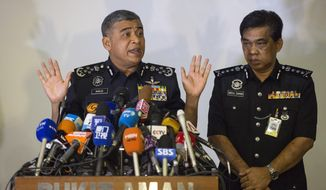 Malaysia's Inspector-General of Police Khalid Abu Bakar, left, speaks as Selangor Police Chief Abdul Samah Mat listens during a press conference at the Bukit Aman national police headquarters in Kuala Lumpur, Malaysia, Wednesday, Feb. 22, 2017. Malaysia's police chief says a North Korean Embassy official is among eight North Korean suspects in last week's fatal poisoning of the half brother of Pyongyang's leader Kim Jong Un in Kuala Lumpur's airport. (AP Photo/Alexandra Radu)