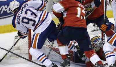 Edmonton Oilers center Ryan Nugent-Hopkins (93) scores a goal against Florida Panthers goalie James Reimer, right, during the second period of an NHL hockey game, Wednesday, Feb. 22, 2017, in Sunrise, Fla. (AP Photo/Lynne Sladky)