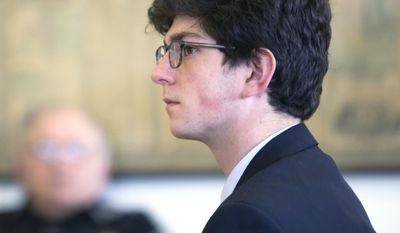 Owen Labrie listens to testimony  on the first day of a hearing on whether he deserves a new trial, on Tuesday, Feb. 21, 2017 in Concord, N.H.  Labrie claims his trial lawyers failed to challenge the felony charge.  He was acquitted in 2015 of raping a 15-year-old classmate as part of a game of sexual conquest at St. Paul's School but was convicted of a felony computer charge requiring him to register as a sex offender. (Geoff Forester /The Concord Monitor via AP, Pool)