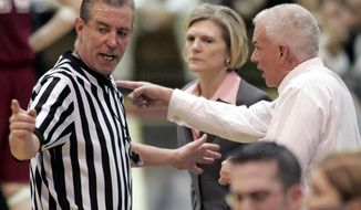 FILE - In a March 5, 2006, file photo, Saint Joseph's coach Cindy Griffin, center, watches as George Washington coach Joe McKeown, right, and referee Dennis DeMayo discuss a shot-clock violation late in the second half of an Atlantic 10 basketball championship semifinal in Philadelphia. DeMayo has had the best view of some of women's college basketball's greatest games over the past 30 years. The 63-year-old official, who has refereed by his estimate over 2,000 games, will call his final one Wednesday, Feb. 22, 2017 when No. 23 Temple visits top-ranked UConn. (AP Photo/George Widman, FIle)