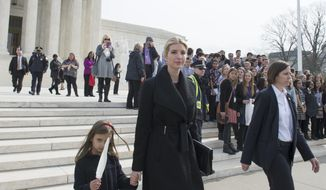 Ivanka Trump, daughter of President Donald Trump, and her daughter Arabella Kushner walk down the steps of the Supreme Court in Washington, Wednesday, Feb. 22, 2017. Trump attended the court session at the encouragement of Justice Anthony Kennedy, who extended her an invitation when they met at the inauguration lunch.  (AP Photo/Molly Riley)