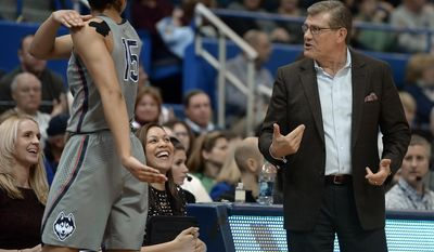 Connecticut coach Geno Auriemma shares a light moment with Gabby Williams, left, as assistant coaches Shea Ralph and Marisa Moseley smile during the second half of the team's NCAA college basketball game against Temple, Wednesday, Feb. 22, 2017, in Hartford, Conn. (AP Photo/Jessica Hill)