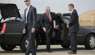 Secretary of State Rex Tillerson exits his limousine at Andrews Air Force Base, Md., Wednesday, Feb. 22, 2017, before his departure to Mexico. President Donald Trump is sending his Tillerson and Homeland Security Secretary John Kelly to Mexico on a fence-mending mission made all the more challenging by the actual fence he wants to build on the southern border. (Carlos Barria via AP, Pool)