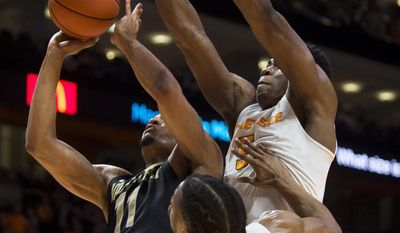 Vanderbilt's Jeff Roberson (11) attempts a shot past Tennessee's Admiral Schofield (5) and Robert Hubbs III (3) during the first half of an NCAA college basketball game Wednesday, Feb. 22, 2017, in Knoxville, Tenn. (Brianna Paciorka/Knoxville News Sentinel via AP)