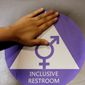 Gender-neutral bathrooms may become more common with the flurry of legislative activity over which public facilities transgender people will be allowed to legally use. (Associated Press) ** FILE **