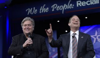 White House Chief of Staff Reince Priebus, right, accompanied by White House strategist Stephen Bannon, speaks at the Conservative Political Action Conference (CPAC) in Oxon Hill, Md., Thursday, Feb. 23, 2017. (AP Photo/Susan Walsh)