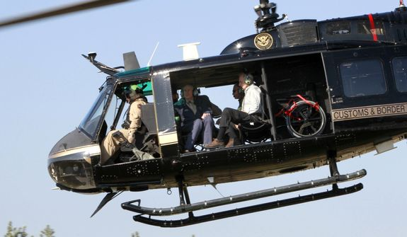 Secretary of Homeland Security John Kelly and Texas Governor Greg Abbott take off in a helicopter tour of the Texas border with Mexico Wednesday, Feb. 1, 2017 at the Texas Department of Public Safety regional headquarters in Weslaco, Texas. (Nathan Lambrecht/The Monitor via AP, Pool)