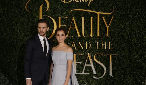 Dan Stevens, left and Emma Watson arrive for the Beauty And The Beast Premiere, in London, Thursday, Feb. 23, 2017. (AP Photo/Alastair Grant)