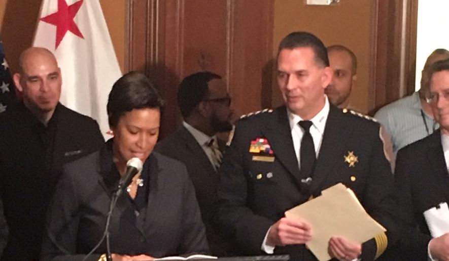 D.C. Mayor Muriel Bowser on Thursday names interim police Chief Peter Newsham as the new leader of the Metropolitan Police Department. Chief Newsham replaces Cathy L. Lanier, who left the department in September to become chief of security for the National Football League. (Photo by Ryan M. McDermott / The Washington Times