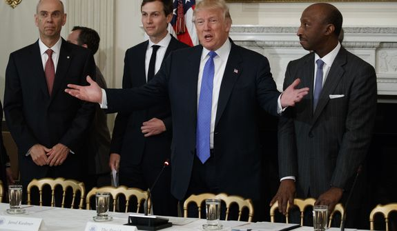 President Donald Trump welcomes manufacturing executives to a meeting in the Roosevelt Room of the White House in Washington, Thursday, Feb. 23, 2017. From left are, Archer Daniels Midland CEO Juan Luciano, White House Senior Adviser Jared Kushner, Trump, and Merck CEO Kenneth Frazier. (AP Photo/Evan Vucci)