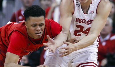 Maryland's Anthony Cowan, left, and Wisconsin's Bronson Koenig (24) go after the ball during the second half of an NCAA college basketball game Sunday, Feb. 19, 2017, in Madison, Wis. (AP Photo/Andy Manis)