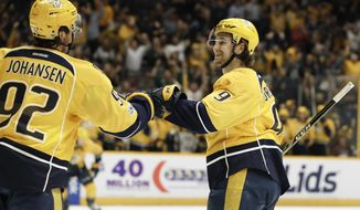 Nashville Predators left wing Filip Forsberg (9), of Sweden, celebrates with Ryan Johansen (92) after Forsberg scored his second goal of the game against the Colorado Avalanche during the second period of an NHL hockey game Thursday, Feb. 23, 2017, in Nashville, Tenn. (AP Photo/Mark Humphrey)