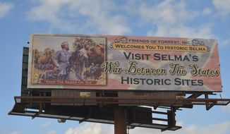 FILE -In this Tuesday, March 3, 2015 file photo, a billboard erected to draw visitors to Civil War history sites in Selma, Ala, is seen. Organizers of an annual Civil War re-enactment and a civil rights commemoration are upset by the mayor's plan to charge them thousands of dollars for police, fire and cleanup services. Organizers of the annual Selma Bridge Crossing Jubilee say they won't pay, and the battle re-enactment was canceled for this year. (AP Photo/Mike Stewart, File)