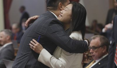 FILE -- In this May 26, 2016 file photo Sen. Janet Nguyen, R-Fountain Valley, is congratulated by Sen. Richardo Lara, D-Bell Gardens, after the Senate approved one of her bills, in Sacramento, Calif. Lara, who was presiding over the Senate, ordered Nguyen removed from the floor Thursday, Feb. 23, 2017, after she refused to stop delivering a speech criticizing former Sen. Tom Hayden for his anti-war activism in Vietnam. (AP Photo/Rich Pedroncelli, File)