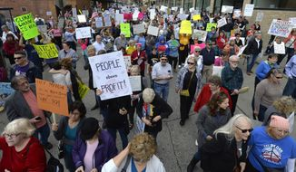 Protesters in the hundreds gather to protest the appearance of Senate Majority Leader Mitch McConnell R-Ky., who was scheduled to speak at a gathering of the Northern Kentucky Chamber of Commerce and the Cincinnati USA Regional Chamber, Thursday, Feb. 23, 2017, in Covington, Ky. Protesters have been following McConnell at each of his public events as he tours the state during the congressional recess. They are angry with him for his support of Republican President Donald Trump.  (AP Photo/Timothy D. Easley)