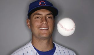 This Feb 21, 2017 file photo show Chicago Cubs' Albert Almora Jr. as he juggles during the team's photo day in Mesa, Ariz. (AP Photo/Morry Gash)