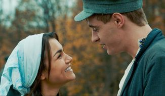 """This image released by Roadside Attractions shows Samantha Barks, left, and Max Irons in a scene from, """"Bitter Harvest."""" (Roadside Attractions via AP)"""