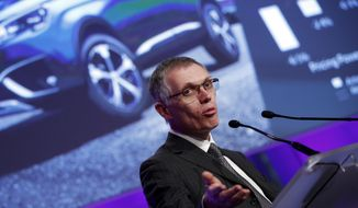 PSA Peugeot Citroen Chief Executive Carlos Tavares delivers his speech during the presentation of the company's 2016 full year results, in Paris, Thursday, Feb.23, 2017. French carmaker PSA Group saw its profits jump last year and is giving dividends for the first time since 2011, burnishing its image as it weighs a buyout of General Motors' money-losing European operations. (AP Photo/Christophe Ena)