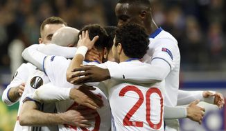 Lyon' players celebrate after winning against AZ Alkmaar during the round of 32, second leg, Europa League soccer match between Lyon and AZ Alkmaar, in Decines, near Lyon, central France, Thursday, Feb. 23, 2017. (AP Photo/Laurent Cipriani)