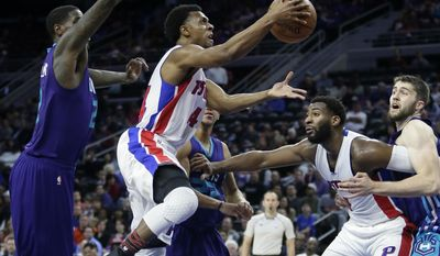 Detroit Pistons guard Ish Smith, second from left, goes to the basket past Charlotte Hornets forward Marvin Williams (2) as Pistons center Andre Drummond blocks out Hornets center Mike Tobey, right, during the first half of an NBA basketball game Thursday, Feb. 23, 2017, in Auburn Hills, Mich. (AP Photo/Duane Burleson)