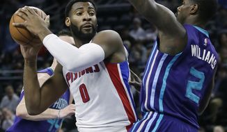 Detroit Pistons center Andre Drummond (0) tries to go to the basket against Charlotte Hornets forward Marvin Williams (2) during the first half of an NBA basketball game Thursday, Feb. 23, 2017, in Auburn Hills, Mich. (AP Photo/Duane Burleson)