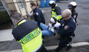 Diana Mejia, center, an activist with Winds of the Spirit N.J., is carried by Elizabeth Police officers while being arrested during an immigration protest outside of a detention center, Thursday, Feb. 23, 2017, in Elizabeth, N.J. Mejia and four other activists were taken into custody during the rally. (AP Photo/Julio Cortez)