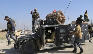 Iraqi Federal police deploy after regaining control of the town of Abu Saif, west of Mosul, Iraq, Wednesday, Feb. 22, 2017. Iraq's government-sanctioned paramilitary forces, made up mainly of Shiite militiamen, have launched a new push to capture villages west of the city of Mosul from Islamic State militants.(AP Photo/Khalid Mohammed)