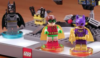 """Build Batgirl and Robin to help the Dark Knight in """"Lego Dimensions: The Lego Batman Story Pack"""" video game adventure."""