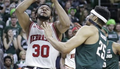 Nebraska forward Ed Morrow (30) makes a layup while defended by Michigan State forward Kenny Goins (25) during the first half of an NCAA college basketball game, Thursday, Feb. 23, 2017, in East Lansing, Mich. (AP Photo/Carlos Osorio)