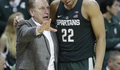 Michigan State coach Tom Izzo talks with guard Miles Bridges (22) during the second half of the team's NCAA college basketball game against Nebraska, Thursday, Feb. 23, 2017, in East Lansing, Mich. (AP Photo/Carlos Osorio)