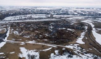 This aerial photo provided the Morton County Sheriff Department shows the closed Dakota Access pipeline protest camp near Cannon Ball, N.D., Thursday, Feb. 23, 2017.  Authorities on Thursday cleared the camp where opponents of the pipeline had gathered for the better part of a year, searching tents and huts and arresting dozens of holdouts who had defied a government order to leave. (Morton County Sheriff Department via AP)