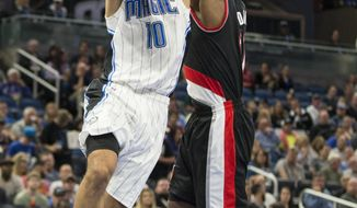 Orlando Magic guard Evan Fournier (10) drives to the basket and is fouled by Portland Trail Blazers forward Ed Davis during the first half of an NBA basketball game in Orlando, Fla., Thursday, Feb. 23, 2017. (AP Photo/Willie J. Allen Jr.)