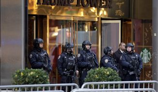 New York City Police stand guard outside Trump Tower in New York, in this Nov. 18, 2016, file photo. (AP Photo/Richard Drew, File)