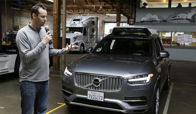 FILE - In this Dec. 13, 2016, file photo, Anthony Levandowski, head of Uber's self-driving program, speaks about their driverless car in San Francisco. A self-driving car company founded by Google is accusing a former top engineer of stealing pivotal technology that is propelling Uber's effort to assemble a fleet of automated vehicles for its popular ride-hailing service. The complaint cites evidence that Levandowski, a former manager in Google's self-driving car project, loaded 14,000 confidential files on a laptop before leaving to start his own company in 2016. (AP Photo/Eric Risberg, File)