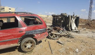 This image released by the Thiqa News Agency shows damaged cars after a suicide attacker blew his small pick-up truck outside a security office in Sousian village, about 8 kilometers (5 miles) north of al-Bab, Friday, Feb. 24, 2017. A car bombing north of a Syrian town just captured by Turkish forces and Syrian opposition fighters from the Islamic State group killed several people, mostly civilians who had gathered trying to go back home, Turkey's news agency and Syrian activists said. (Thiqa News Agency, via AP)