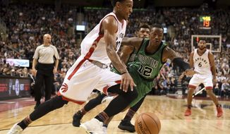 Toronto Raptors' DeMar DeRozan drives for the net as Boston Celtics' Terry Rozier (12) defends during the second half of an NBA basketball game Friday, Feb. 24, 2017, in Toronto. (Frank Gunn/The Canadian Press via AP)