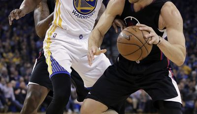Los Angeles Clippers' Blake Griffin, right, drives against Golden State Warriors' Kevin Durant (35) during the first half of an NBA basketball game Thursday, Feb. 23, 2017, in Oakland, Calif. (AP Photo/Ben Margot)