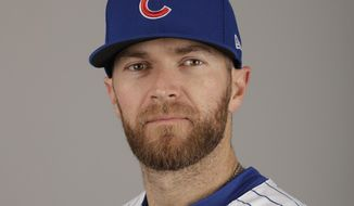 FILE - In this This is a 2017 file photo showing Chicago Cubs' Wade Davis. Wade Davis was a promising starting pitcher when he made his major league debut for Joe Maddon and the Tampa Bay Rays almost eight years ago. Then he was a reliever, and then a starter again and then a reliever.  Now he gets the ball from Maddon once again _ only this time as the closer for the Chicago Cubs.  (AP Photo/Morry Gash, File)