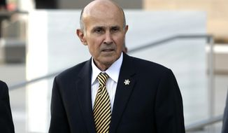 FILE - In this Dec. 19, 2016 file photo, former Los Angeles County Sheriff Lee Baca leaves federal court in Los Angeles. Baca went on trial on federal corruption charges Friday, Feb. 24, 2017, stripped of a ceremonial badge and unable to present a defense that might have won him sympathy if jurors knew he was in the early stage of Alzheimer's disease. Instead, his lawyer dropped only a hint of what he couldn't say as he attacked the obstruction of justice and lying charges as an outgrowth of a rookie FBI investigation riddled with blunders. (AP Photo/Nick Ut, File)